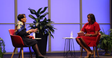 Mary Frances Early sits on a stage in a discussion with Joni Taylor.