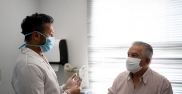 Patient in a medical consult wearing face mask