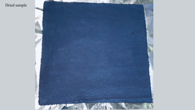 A piece of indigo-dyed cotton fabric is shown after it has dried