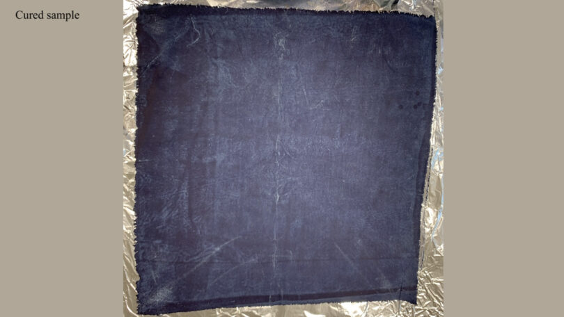 A piece of indigo-dyed fabric is shown after it has been distressed