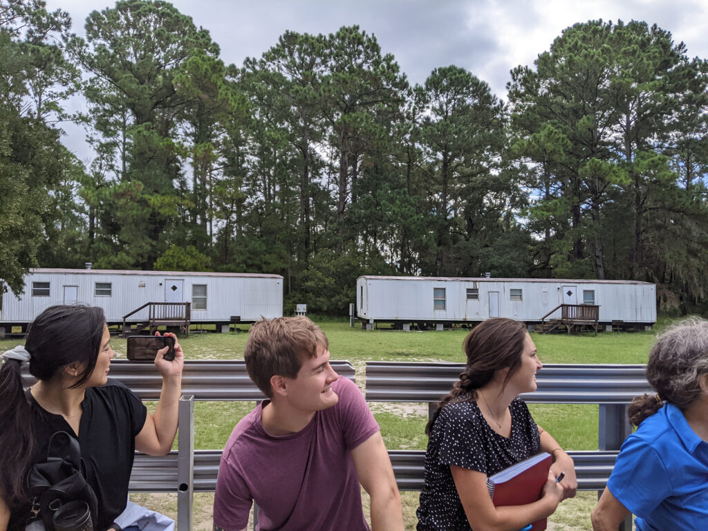 Students aboard a flatbed truck examine accommodation options at the Marine Institute.