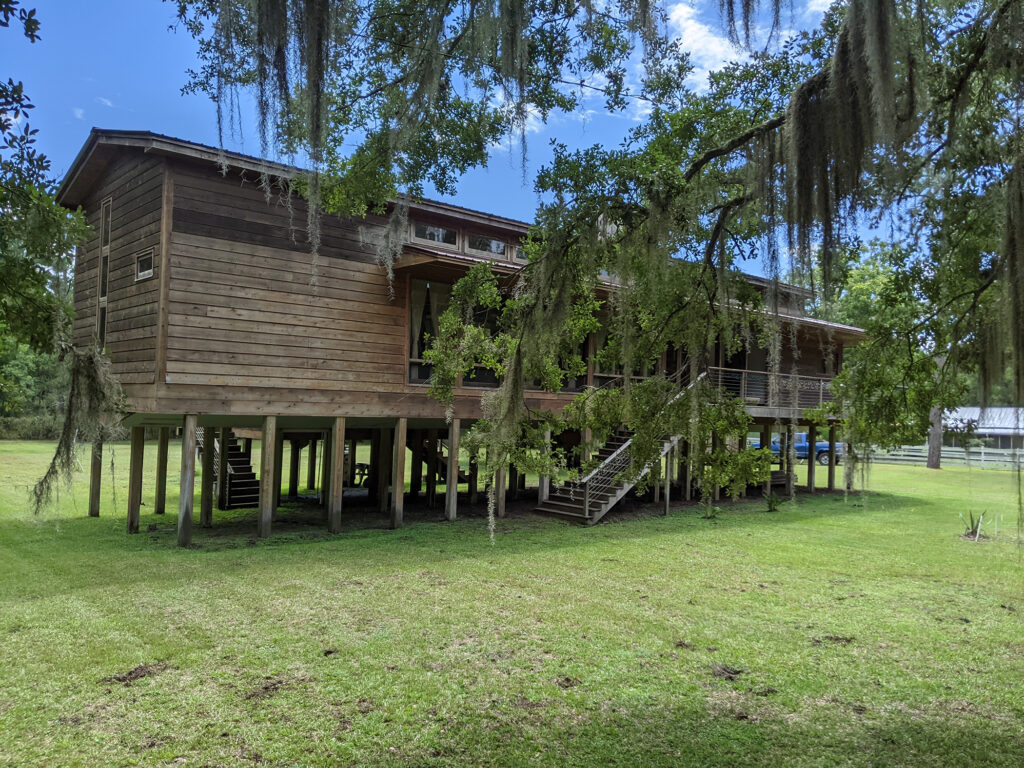 Exterior of a house built on stilts to prevent flooding.